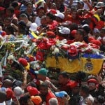 The coffin of Hugo Chavez is driven through the streets of Caracas, after leaving the military hospital where he died of cancer