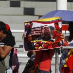 Supporters of Venezuela's late President Hugo Chavez line up to view his body in state at the Military Academy in Caracas