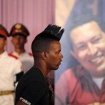 A youth attends a tribute in honor of the late President Hugo Chavez at Cuban independence hero Jose Marti's memorial in Havana