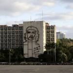 People line up beside the Interior Ministry to attend a tribute in honor of late President Hugo Chavez in Havana's Revolution Square