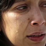 A medical student from Venezuela cries during a tribute in honor of the late President Hugo Chavez at Cuban independence hero Jose Marti's memorial in Havana