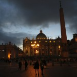 People walk in Saint Peter's Square at the Vatican