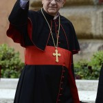 Cardinal Geraldo Agnelo of Brazil waves as he arrives for a meeting at the Vatican