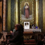 People attend a mass conducted by Cardinal Jorge Urosa Savino of Venezuela in honor of late Venezuelan President Chavez in Rome