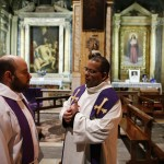 Priests talk before a mass conducted by Cardinal Jorge Urosa Savino of Venezuela in honor of the late Venezuelan President Chavez in Rome