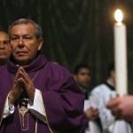 A priest attends a Mass conducted by Cardinal Jorge Urosa Savino of Venezuela in honor of the late Venezuelan President Hugo Chavez in Rome