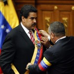 Venezuelan Vice President Maduro receives the sash from National Assembly President Cabello during his swearing-in ceremony as caretaker president following the death of President Chavez in Caracas