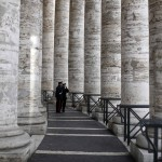Carabinieri stand in the colonnade in Saint Peter's Square at the Vatican