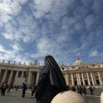 A nun stands in Saint Peter's Square at the Vatican