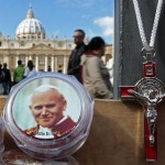 A picture of the late Pope John Paul II is seen on a rosary, for sale in Saint Peter's Square