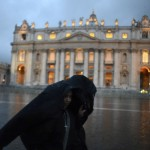 Nuns shelter from the rain as they stroll through Saint Peter's Square