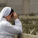 """A nun prays while cardinals hold the mass """"pro eligendo pontifice"""" at Saint Peter's Basilica before the Conclave at the Vatican"""