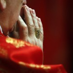 A Cardinal prays during a mass in St. Peter's Basilica at the Vatican