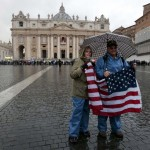People in Saint Peter's Square hold a U.S. flag as the conclave begins in order to elect a successor to Pope Benedict