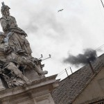 Black smoke rises from the chimney on the roof of the Sistine Chapel in the Vatican City