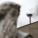 Black smoke rises from the chimney on the Sistine Chapel on second day of voting to elect a new pope at the Vatican