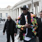 Former basketball star Dennis Rodman, a five-times NBA champion, walks outside Saint Peter's Square at the Vatican
