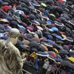 Faithful hold umbrellas as they wait in Saint Peter's Square during the conclave at the Vatican