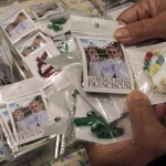 The first batch of rosaries adorned with a picture of the newly-elected Pope Francis are displayed for customers at a souvenir shop at the Vatican