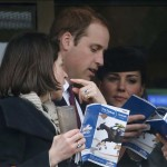 Britain's Prince William and his wife Catherine, Duchess of Cambridge look at racecards during the first race at the Cheltenham Festival horse racing meet in Gloucestershire