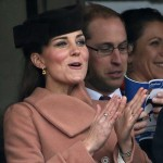 Britain's Prince William and Catherine, Duchess of Cambridge react as they watch the race at the Cheltenham Festival horse racing meet in Gloucestershire, western England