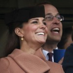 Britain's Prince William and his wife Catherine, Duchess of Cambridge react during the second race at the Cheltenham Festival horse racing meet in Gloucestershire