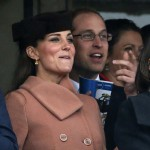 Britain's Prince William and Catherine, Duchess of Cambridge, react as they watch the second  race at the Cheltenham Festival horse racing meet in Gloucestershire