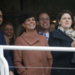 Britain's Prince William and his wife Catherine, Duchess of Cambridge, react during the second race at the Cheltenham Festival horse racing meet in Gloucestershire