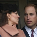 Britain's Prince William talks to his wife Catherine, Duchess of Cambridge during the second race at the Cheltenham Festival horse racing meet in Gloucestershire
