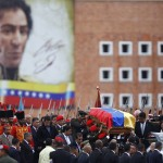 Pallbearers carry the coffin of Venezuela's late President Hugo Chavez to a hearse prior to a funeral parade in Caracas