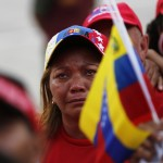 A woman cries while attending the funeral parade of Venezuela's late President Hugo Chavez in Caracas
