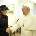 Argentine President Cristina Fernandez shakes hands with newly elected Pope Francis during a private meeting at the Vatican