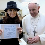 Argentine President Cristina Fernandez de Kirchner shows a scroll given to her by newly elected Pope Francis at the Vatican City