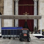 A tractor pulls a load of chairs in Saint Peter's Square at the Vatican, one day before Pope Francis' inaugural mass