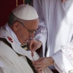 The pallium is fitted on Pope Francis during his inaugural mass in Saint Peter's Square at the Vatican