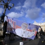 A banner bearing the image of Pope Francis is hung before his inaugural mass in Saint Peter's Square at the Vatican