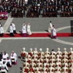 Pope Francis passes cardinals and dignitaries as he takes part in his inaugural mass in Saint Peter's Square at the Vatican