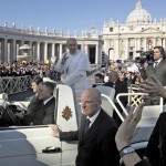 Pope Francis waves as he arrives in Saint Peter's Square for his inaugural mass at the Vatican