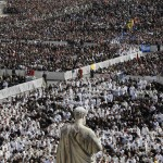 Members of the clergy are seen near a statue of Saint Peter during the inaugural mass of Pope Francis in Saint Peter's Square at the Vatican