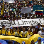Opposition supporters take part in a protest in Caracas