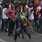 A supporter of the late President Hugo Chavez takes part in a protest in Caracas