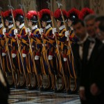 Swiss guards stand as Pope Francis attends an audience with the diplomatic corps at the Vatican
