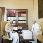 Pope Francis talks with Pope Emeritus Benedict XVI at the Castel Gandolfo summer residence