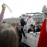 Pope Francis is greeted by the faithful as he arrives to lead the weekly general audience in Saint Peter's Square at the Vatican