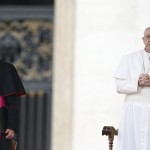 Pope Francis looks on next to Pope Emeritus Benedict XVI's personal secretary Gaenswein as he leads the weekly general audience in Saint Peter's Square at the Vatican