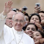 Pope Francis waves as he leaves at the end of the weekly general audience in Saint Peter's Square at the Vatican