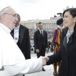 Pope Francis shakes hand with Italian lower house President  Boldrini during the weekly general audience in Saint Peter's Square at the Vatican