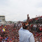 Venezuela's acting President and presidential candidate Nicolas Maduro wearing a feather headgear greets supporters during a campaign rally at the state of Amazonas