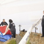 Chilean Judge Carroza and Director of Chile's Forensic Service Bustos, watch the coffin of Chilean poet Pablo Neruda, during the exhumation of his remains in Isla Negra