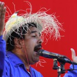 Venezuela's acting President and presidential candidate Maduro wears a hat with a bird on it as he speaks during a campaign rally in Vargas